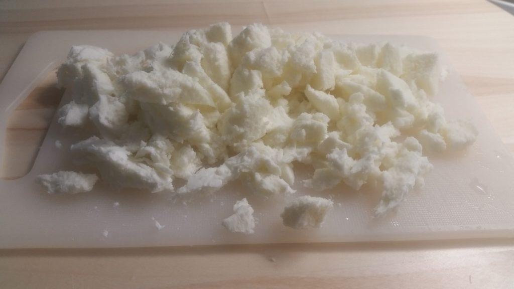 Pasta e cavoli con provola e salsiccia al forno