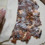 Rotolo di pizza con melanzane a funghetti